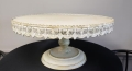 Where to rent ANTIQUE WHITE 22  RD. CAKE STAND in Mt. Airy NC